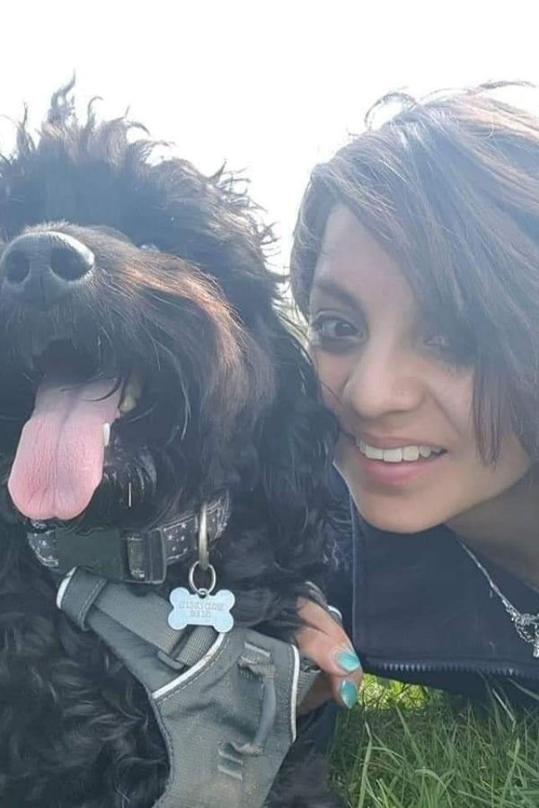 close up of Millie Robinson, dog trainer and her dog