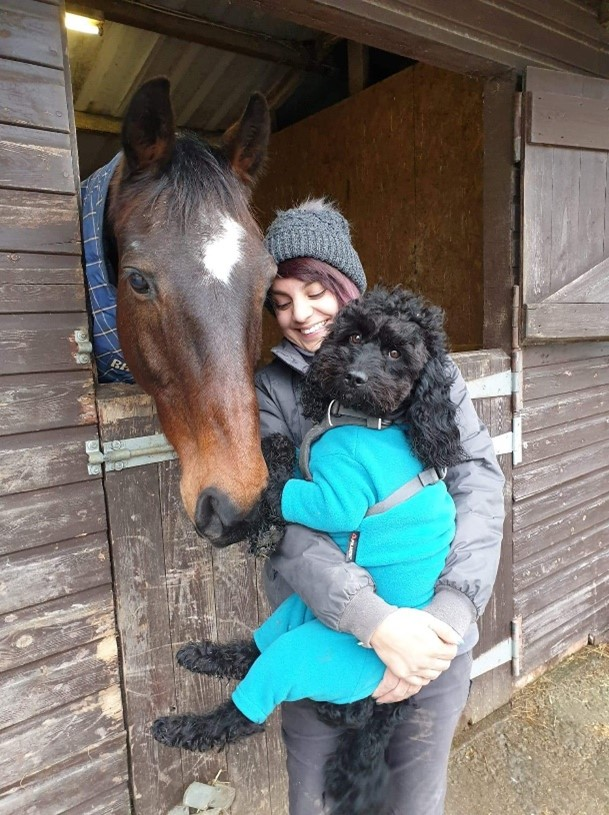 Millie Robinson with her horse and dog